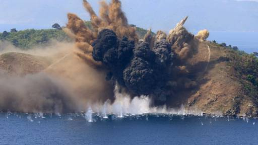 A target island is hit by artillery