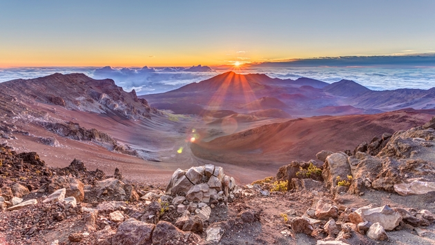 sunrise from the summit of Haleakala volcano on the tropical island of Maui, Hawaii (photo via P_L_photography / iStock / Getty Images Plus)